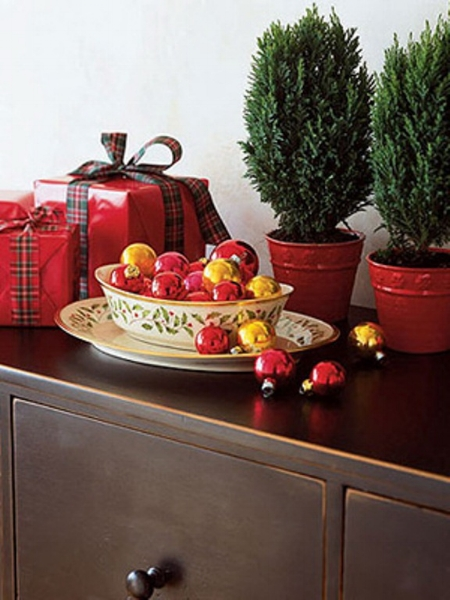 {If you have a dish or container, try color coordinating your ornaments for a complete look.}