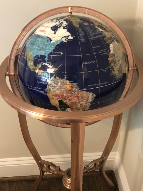 {A unique treasure, the globe's color palette and copper base are eye-catching and inspiring.}
