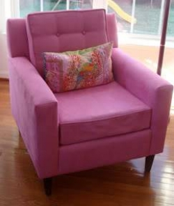 {The upholstered Lucy chair is an example of how a client recently brought color into her decor. From:  Target .}
