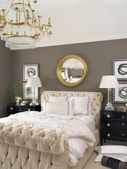 {Gold mirror on grey wall, paired with cream and black. Simply lovely! From:  Shelterness .}