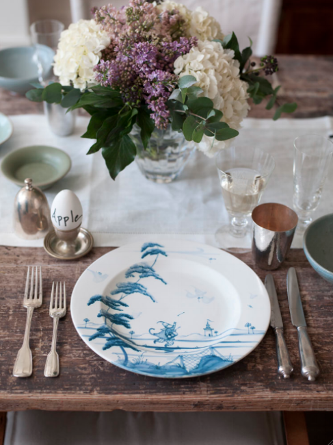 {An unexpected plate on this lovely table. From:  Remodelista .}