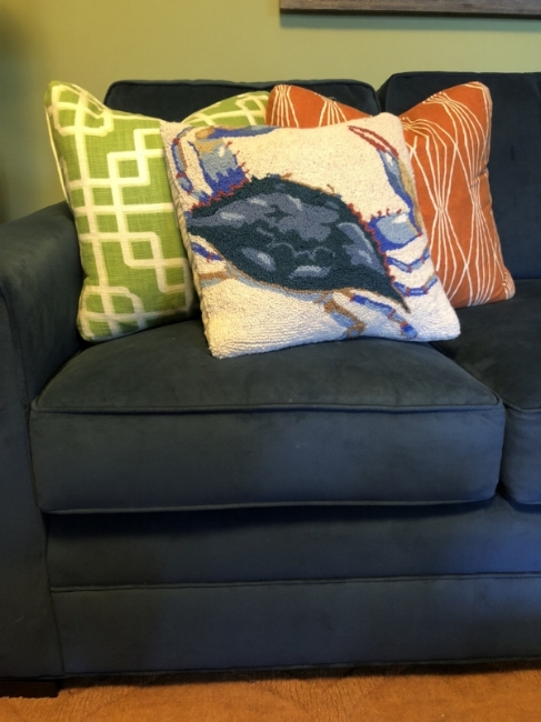 {I coordinated a quintessential Maryland blue crab throw pillow with other bright & bold colors and patterns on my family room sectional.}