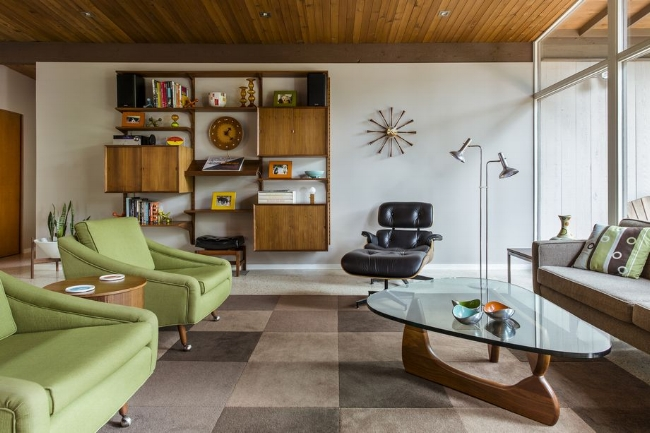 {The mid-century style is perfect for mixing brand new pieces with vintage finds or up cycled treasures, like this living room. From:  Curbed .}