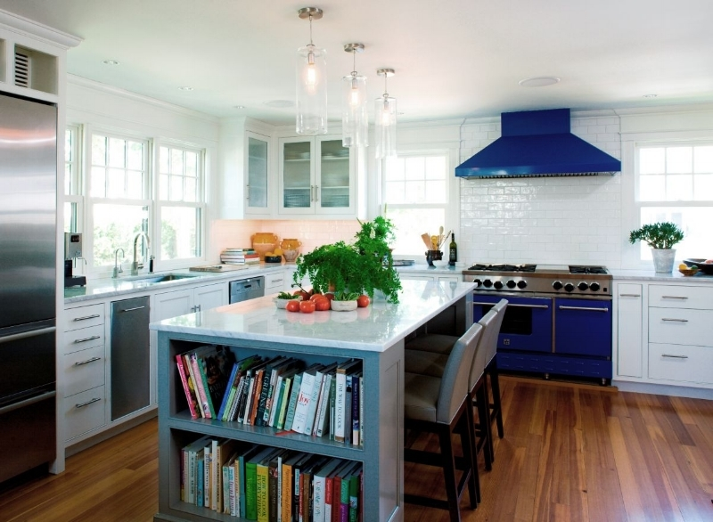 {The focal point of this kitchen is the blue range and hood. From:  SV Design .}