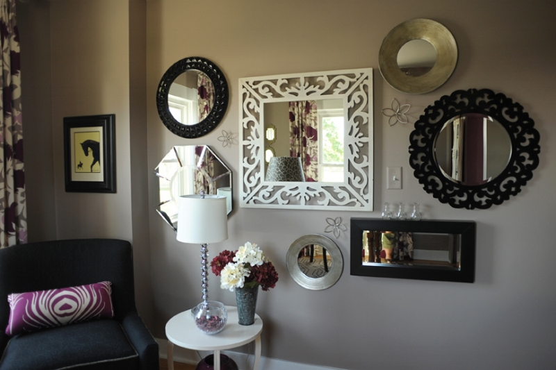 {An assortment of mirrors hung at 60″ on center becomes a focal point of this home office.  Design by April Force Pardoe Interiors .}