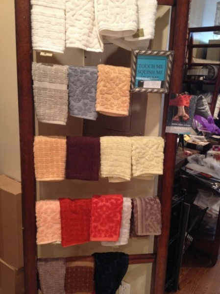{Colorful bath towels at various price points.}