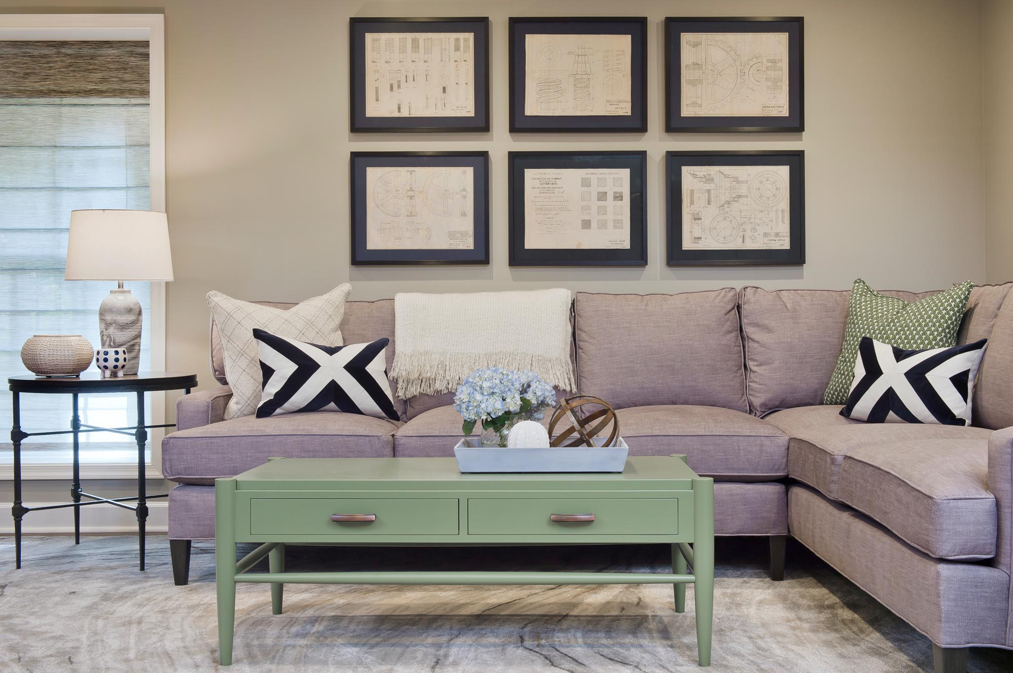 Light violet soft sectional sofa with mint green coffee table