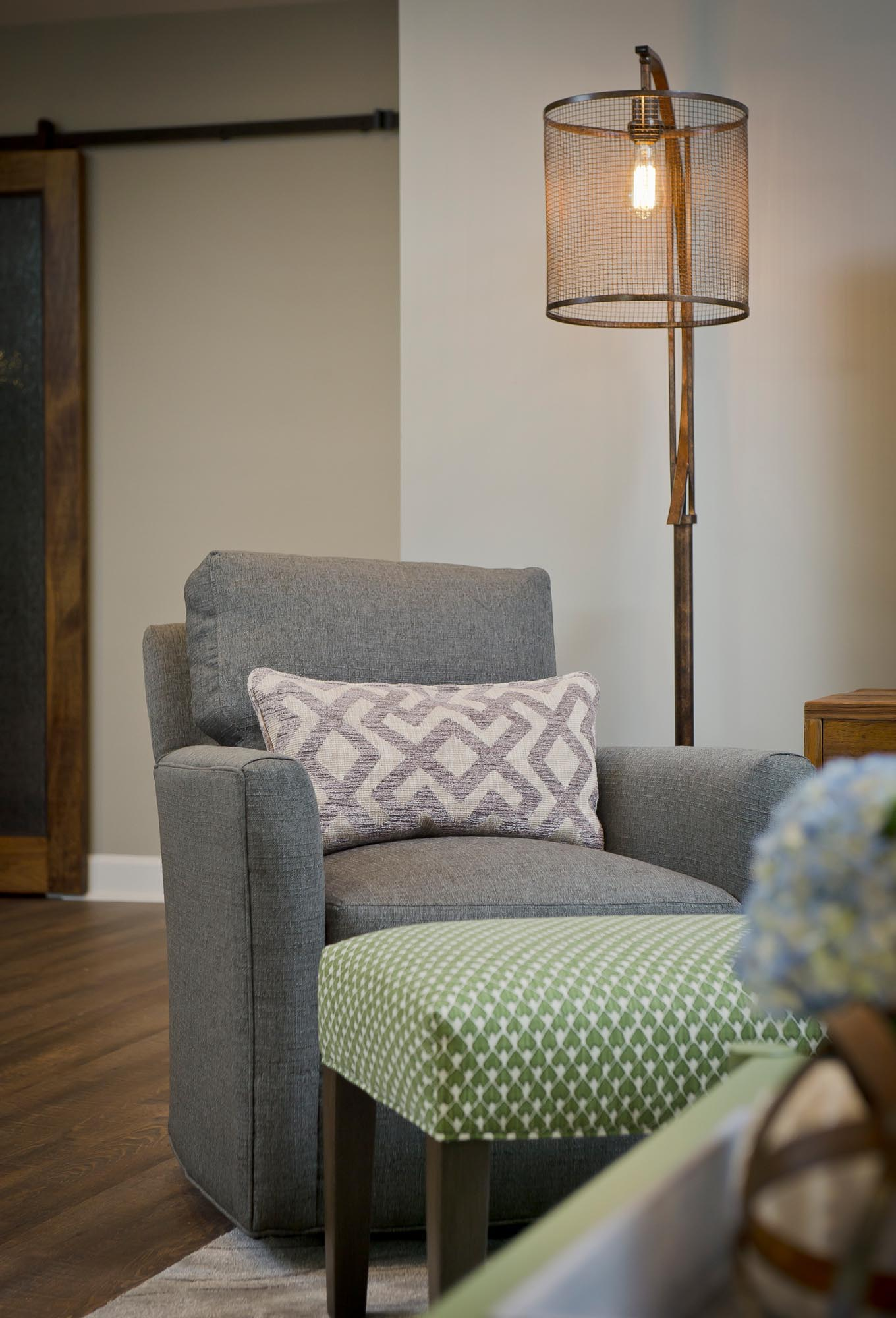 Grey easy chair with mint green ottoman