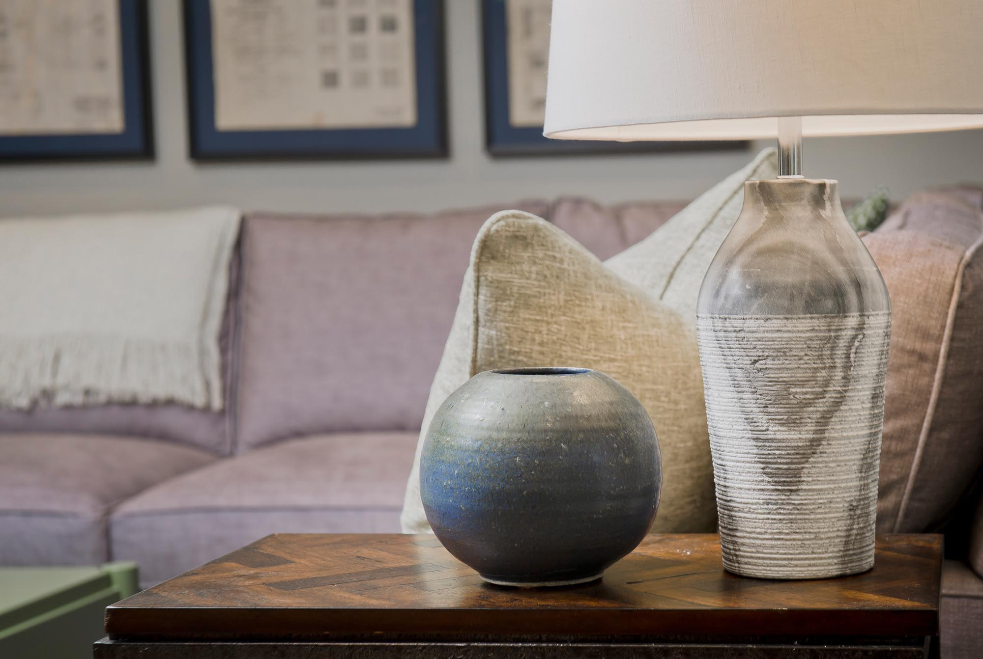 Wooden side table with lamp and clay bowl
