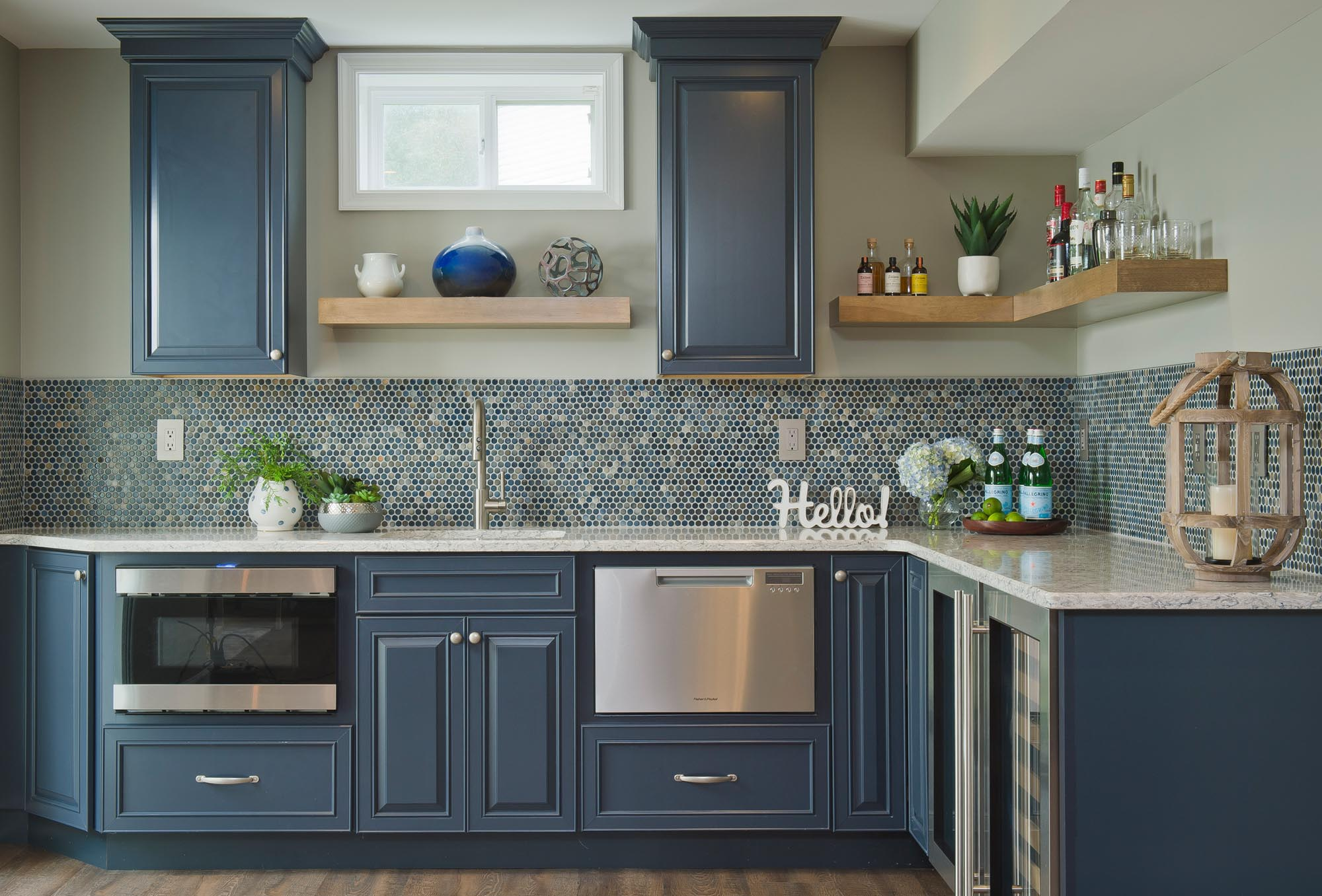 Kitchen area with blue tile and L shaped counter top