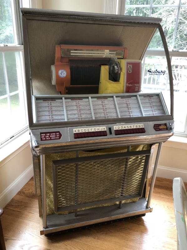 {Jean's spacious kitchen includes a well-stocked jukebox!}
