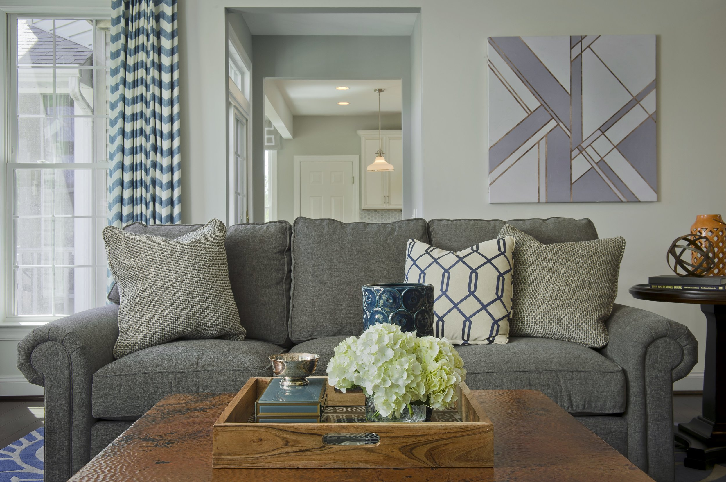 {A tray on a coffee table is an easy place to switch up your decor after the New Year! Design by April Force Pardoe Interiors – Photo by Vince Lupo.}