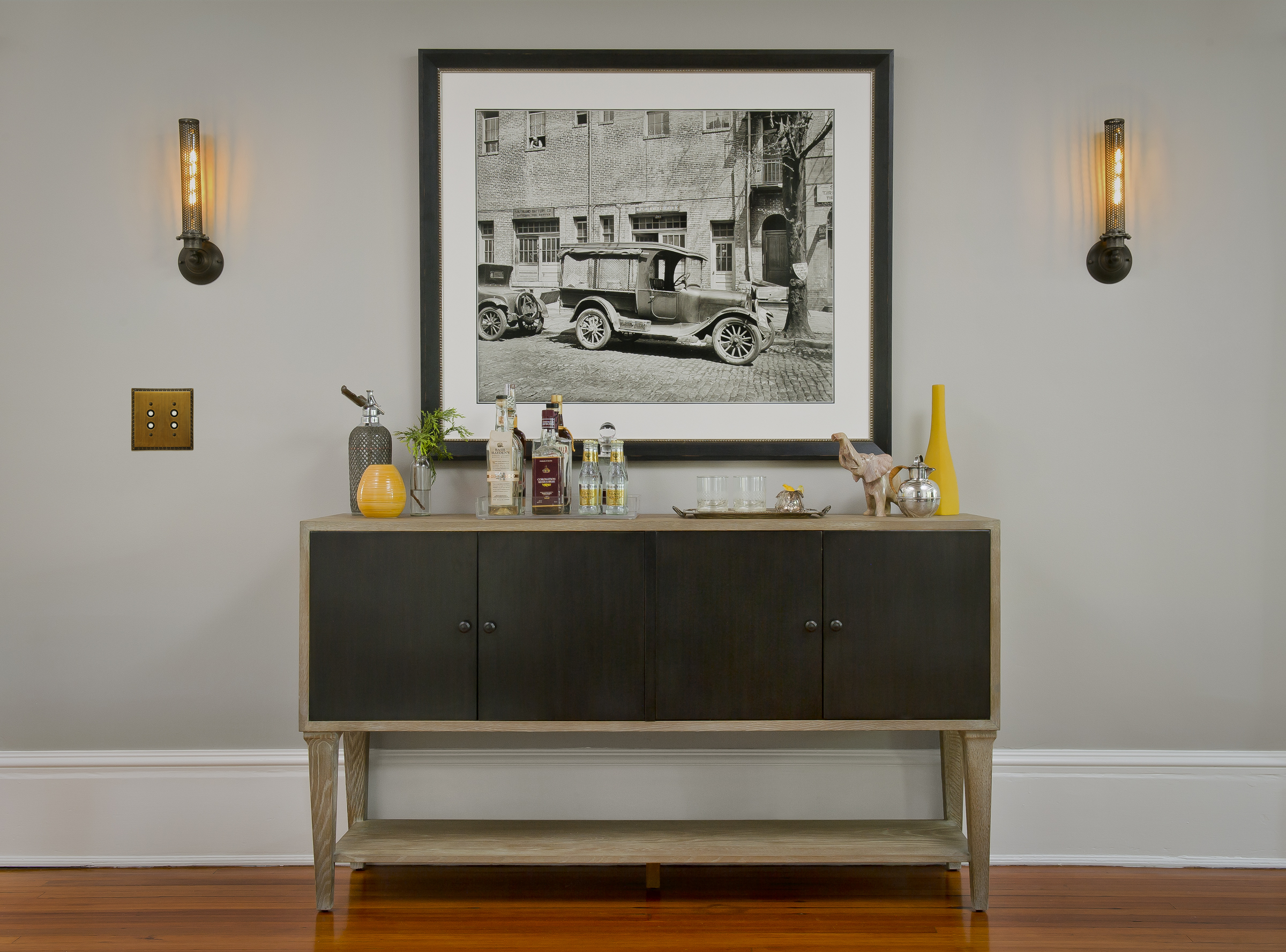 "{A functional sideboard that doubles as a bar ""cart"" allows your living room to be the perfect space for guests to gather when entertaining.  Overhill Road  design by April Force Pardoe Interiors.}"