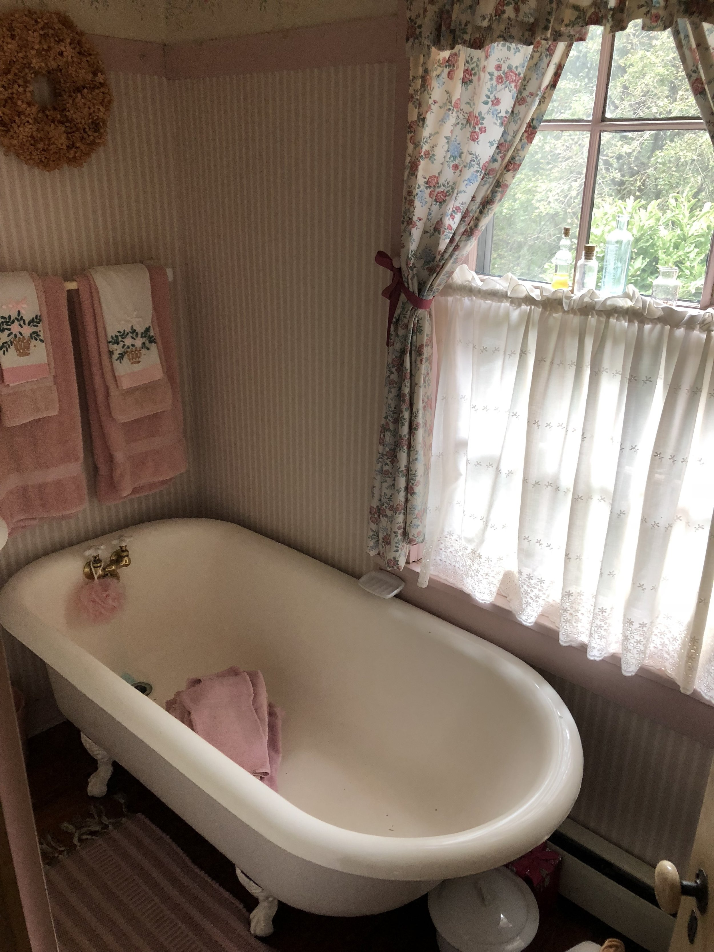 {A tie for favorite room alongside the library, Pat's pink bathroom offers charm and character.}