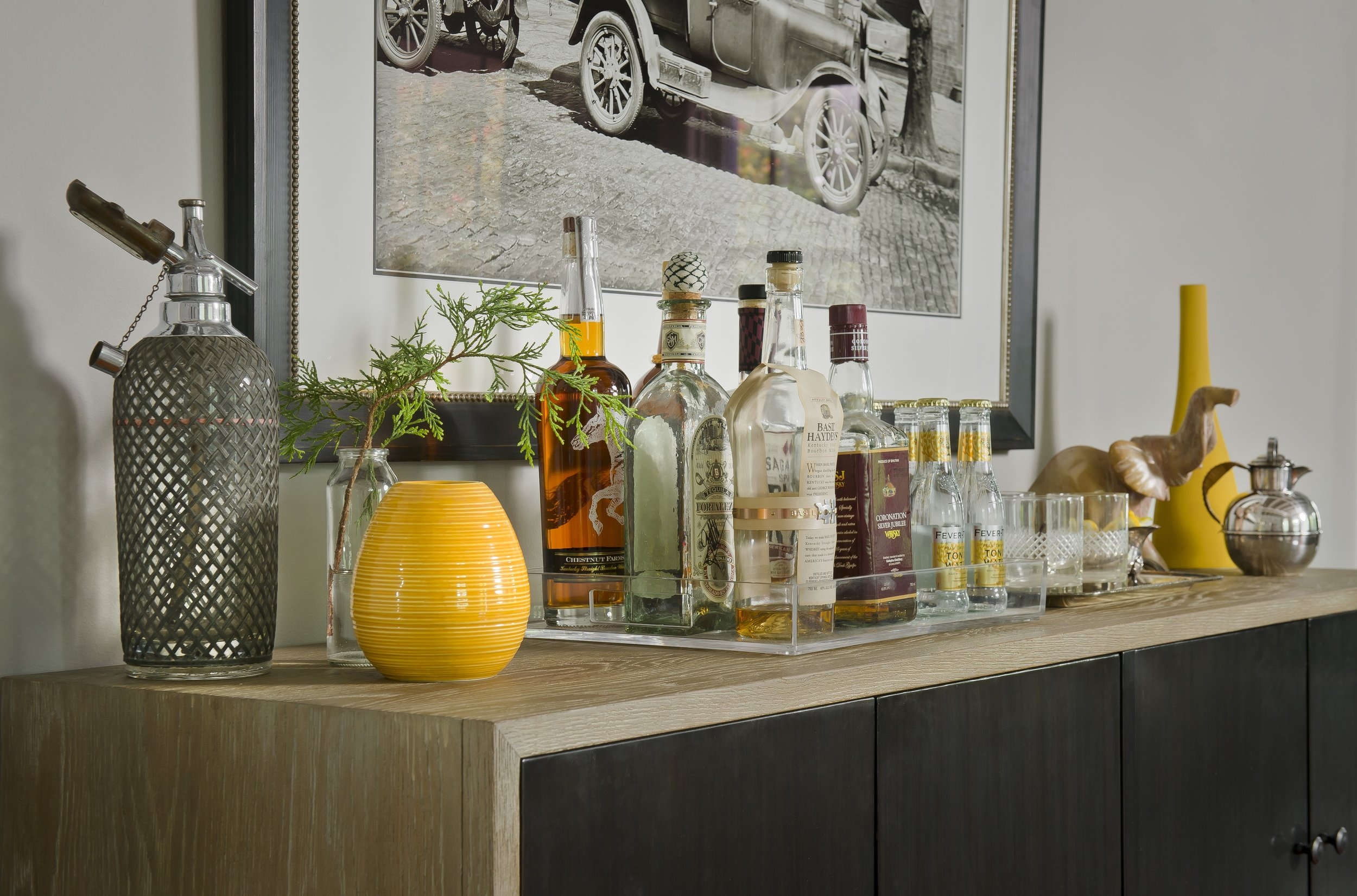 {This bar is set up on a buffet cabinet and is ready to serve drinks with a little bit of personality tossed in!  Overhill Road  design by April Force Pardoe Interiors.}