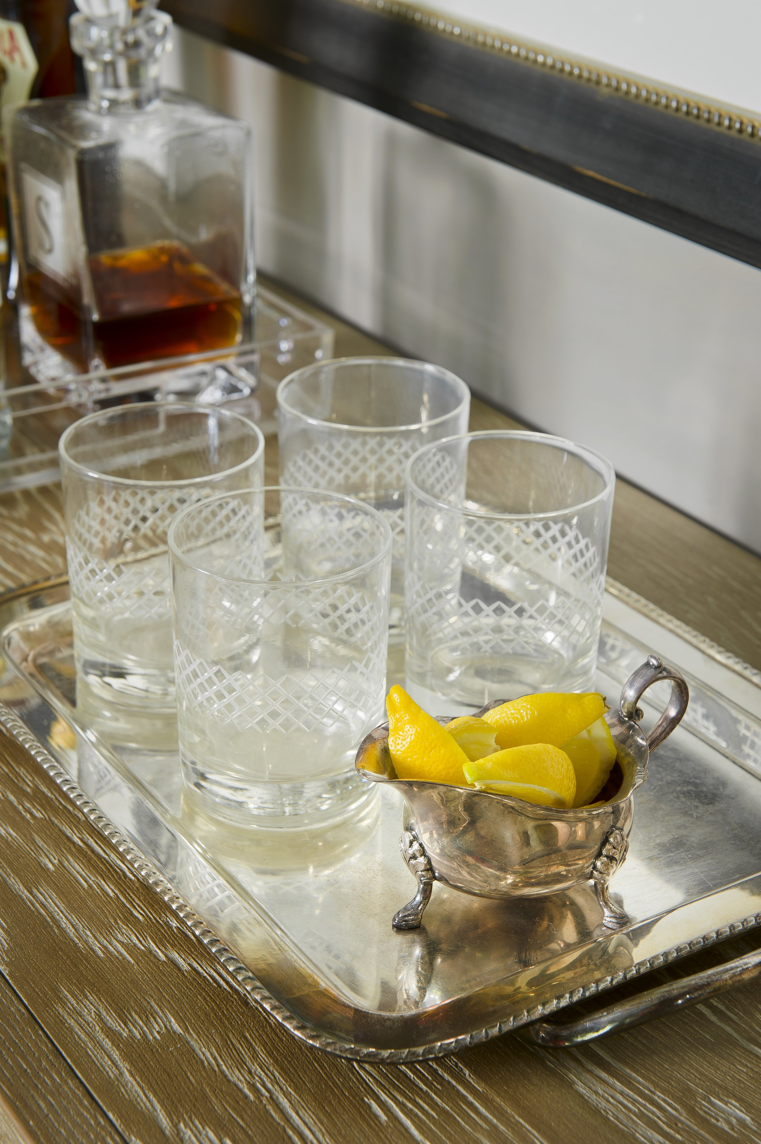 {Pretty glasses and fresh fruit for garnish make for an easy-to-use part of any bar.  Overhill Road  design by April Force Pardoe Interiors.}