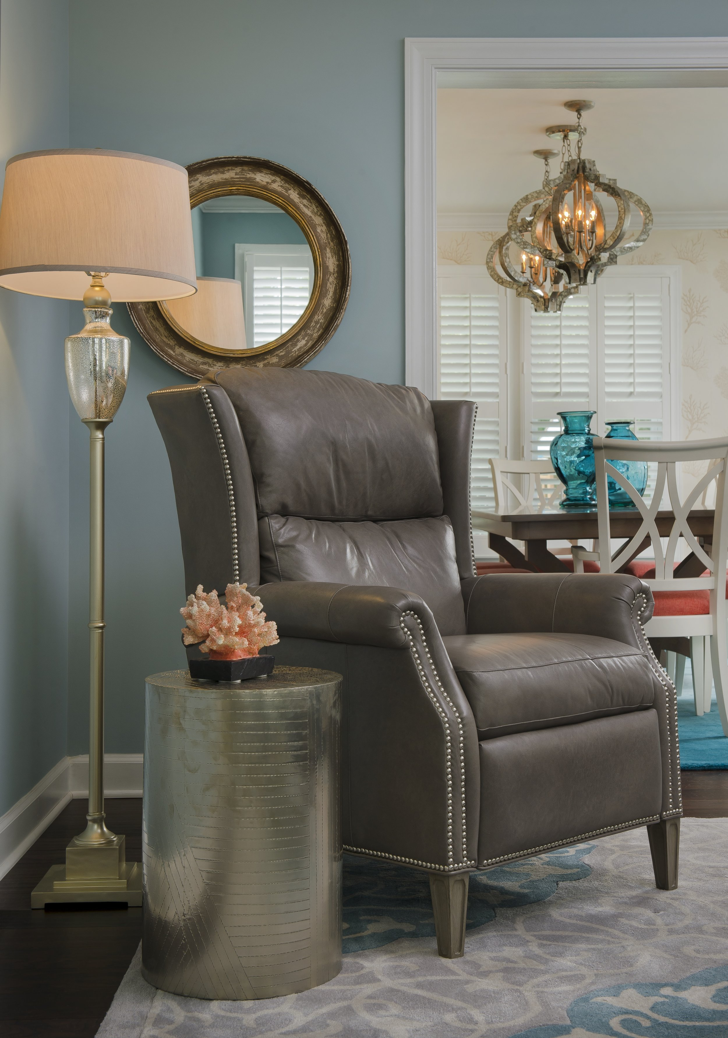 {This recliner is ready for guests with a small drink drop table nearby!  Saddle Ridge Terrace  design by April Force Pardoe Interiors.}