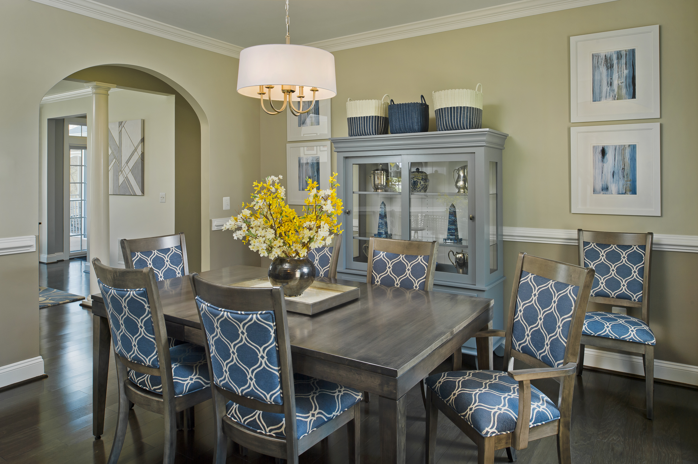 {A painted china cabinet houses the clients collections and complements the wood table nicely, without matching.  MacClinktock Drive  design by April Force Pardoe Interiors.}