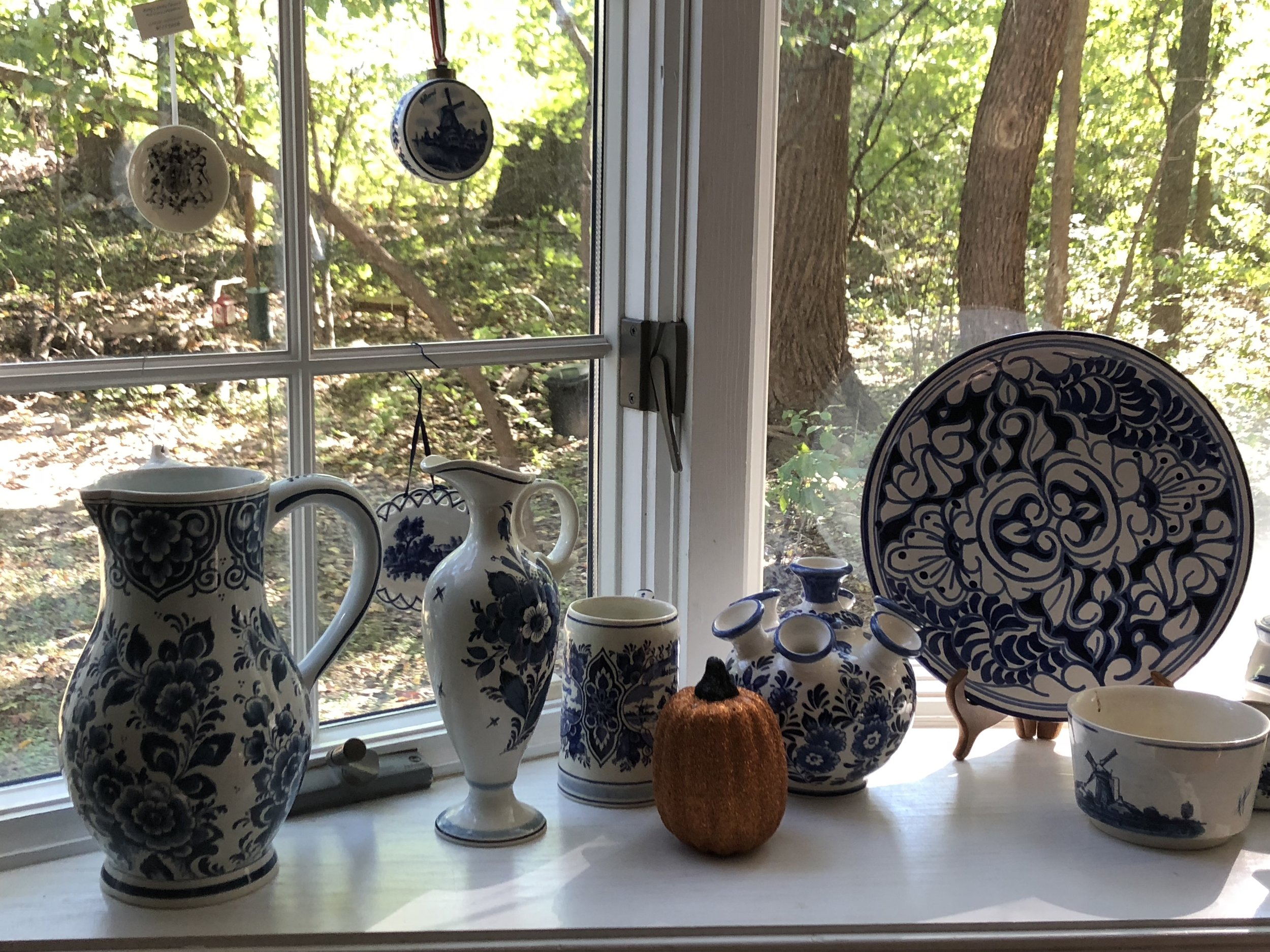 {Debbie's Delft collection makes for an eye-catching window-front display.}