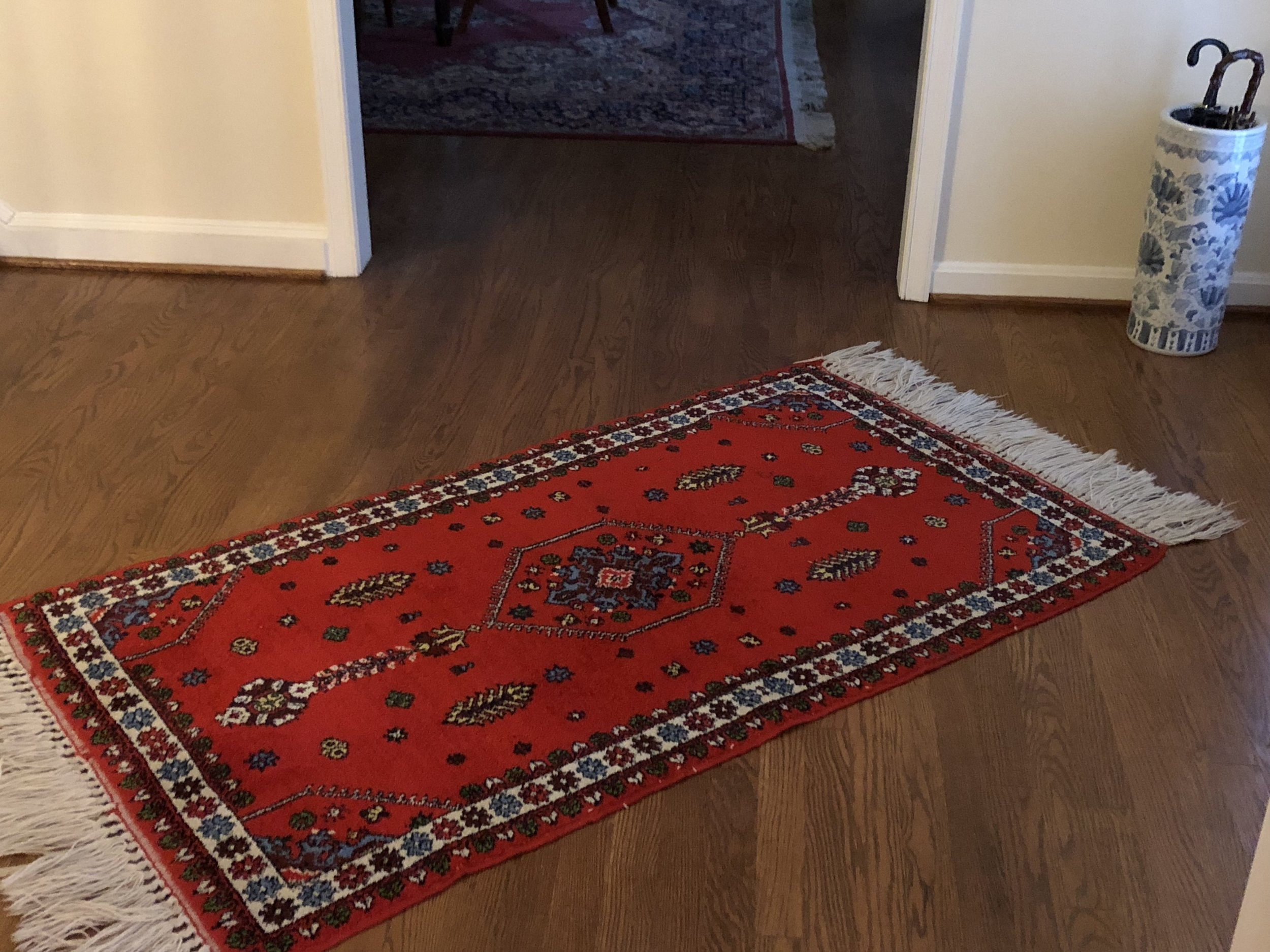 {Debbie hand-carried this vibrant rug back from Morocco, making for a perfect souvenir.}.