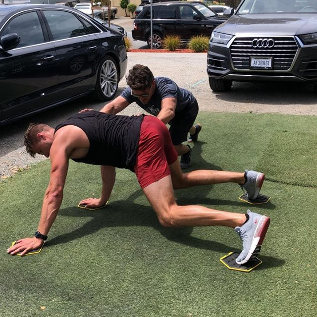 "This one of those ""looks easy on paper but sucks when you do it"" workouts. No sled, no problem. Grab a friend for some buddy sled.  #transformationtuesday #workhard #traininsane . . . My 6'9"" amigo @the_flaherty_effect is always a fun challenge to program for. Since our builds are so different we both excel individually and we each practice our weaknesses. . . . 3 rounds of the interesting stuff:  1️⃣buddy sled - holding the sled is the tough part.  2️⃣ x3 DB modified man-makers 3️⃣ loaded pull-ups  4️⃣ Lebron James press. L to the J. . . . #getbusyliving #workout  #fitnessinyoface #gymtime #motivatedaily"