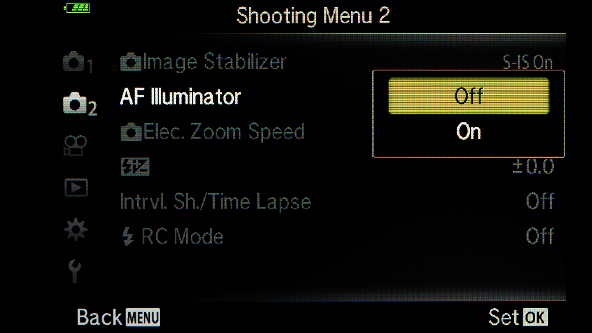 Turn off the AF Illuminator. If photographing a lot in dark, them this option is good to be on. It will help to focus.