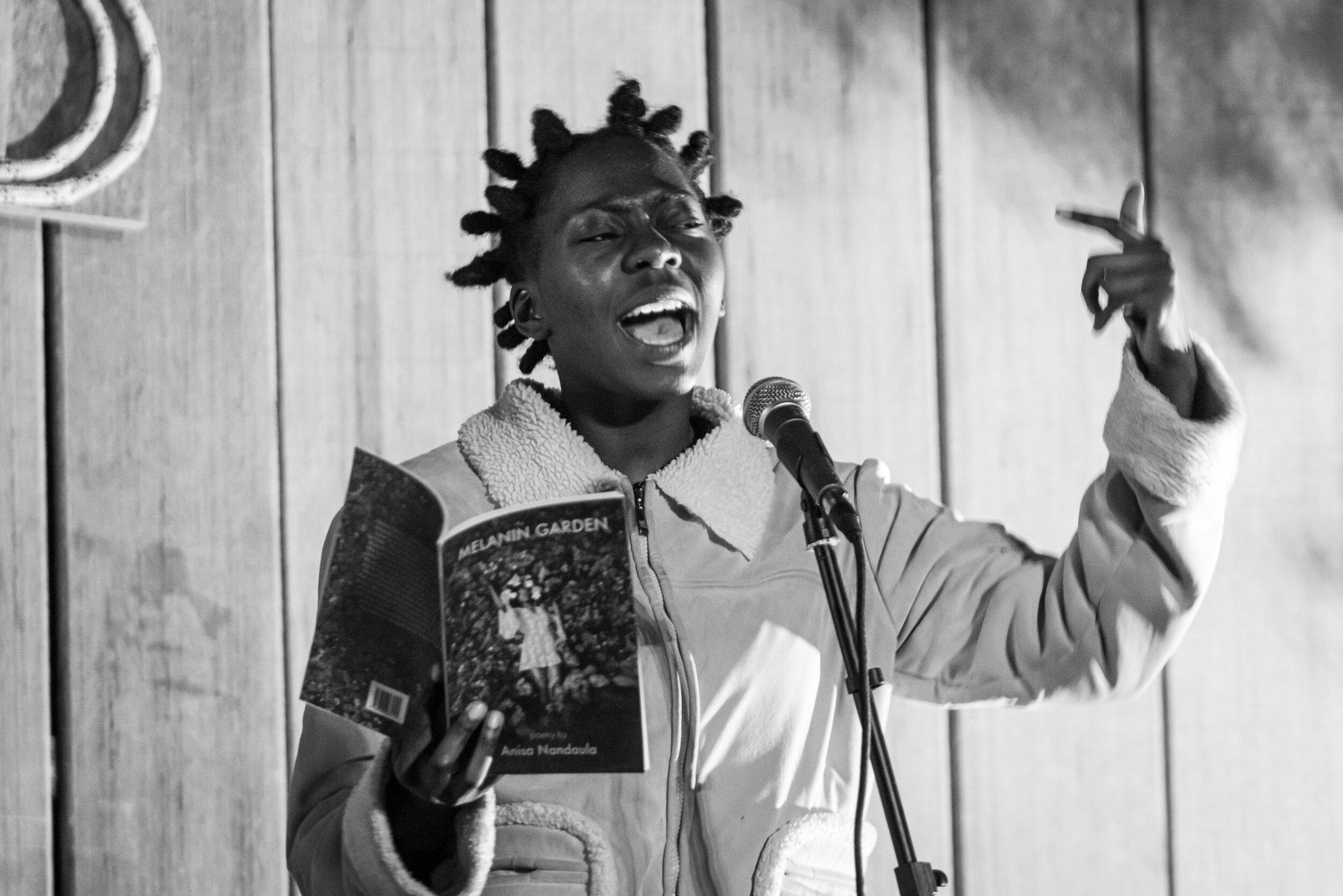 Powerful and revolutionary spoken word artist, Anisa Nandaula.  https://www.anisanandaula.com/