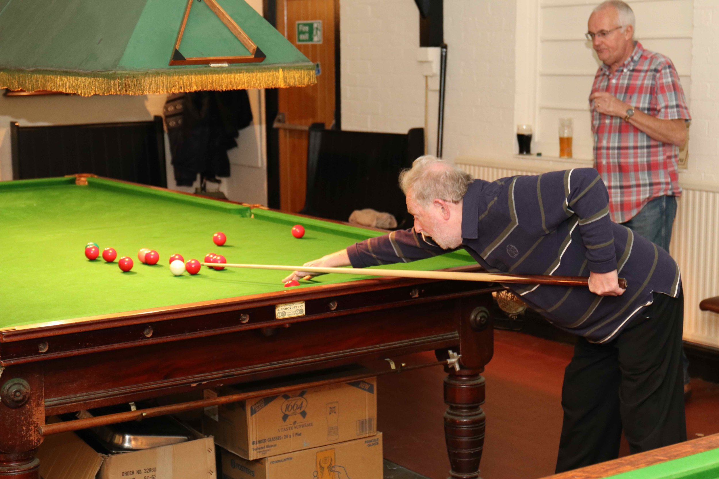 Man playing snooker at the Hall