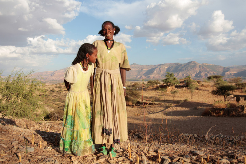Medhin Reda and her daughter in the village of Adi Ha, Ethiopia. Medhin is a participant in the R4 weather insurance program. (Photo: Coco McCabe / Oxfam)