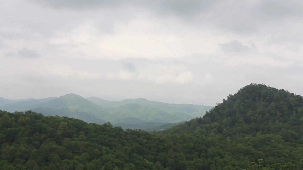 Rockey-Face-view,-clouds,-hills-in-background.png