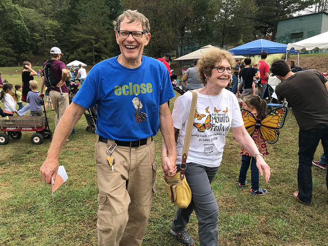 John and his wife walk through the festival