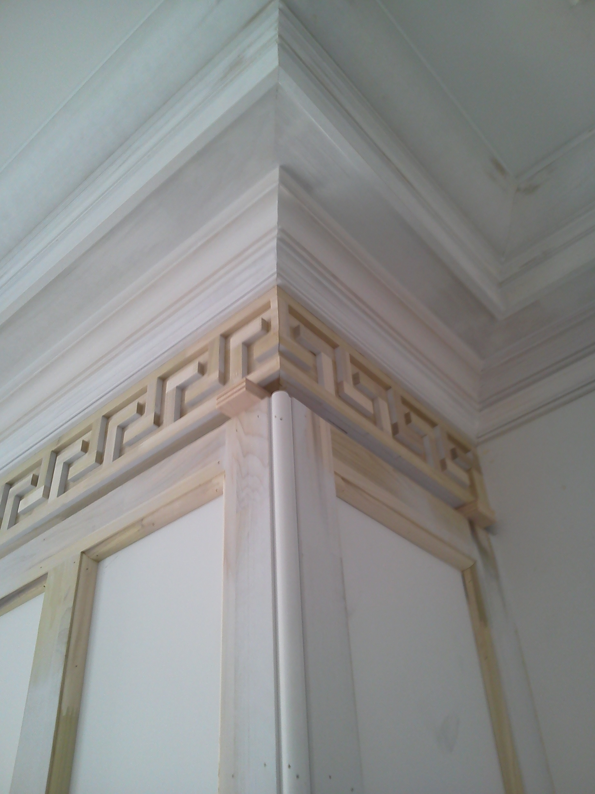 Corner View of the Greek Key with Crown Molding Above