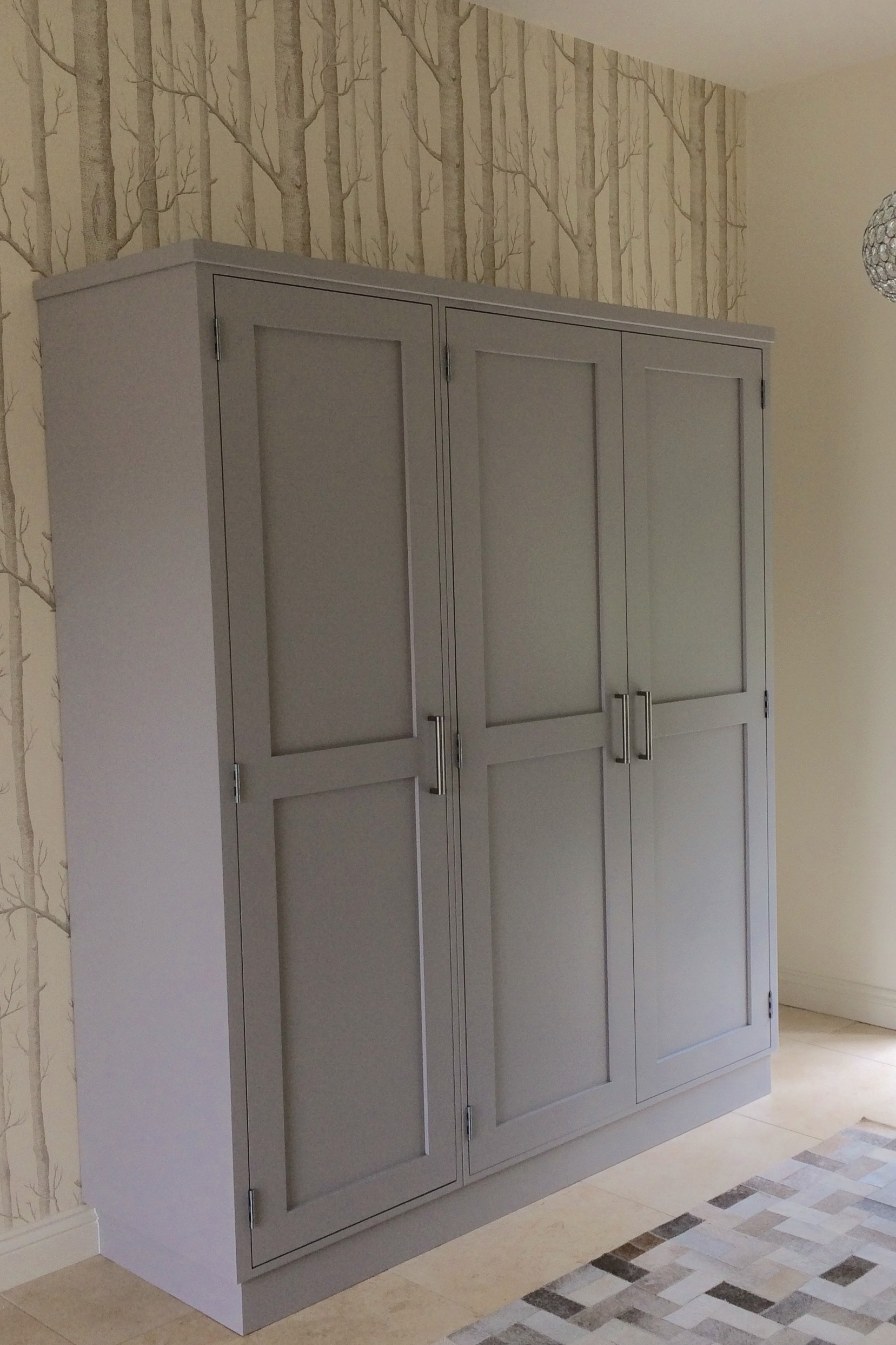 A busy family home needed bespoke storage for school bags and boots! Our solution was to design this stand alone cupboard, finished in Farrow and Ball.