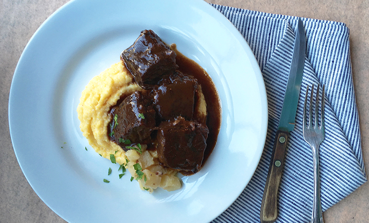 "<a href=""https://www.jamesbeard.org/recipes/braised-short-ribs-with-truffle-polenta-and-empire-apple-compote"" target=""_blank"" />Braised Short Ribs & Polenta</a>"