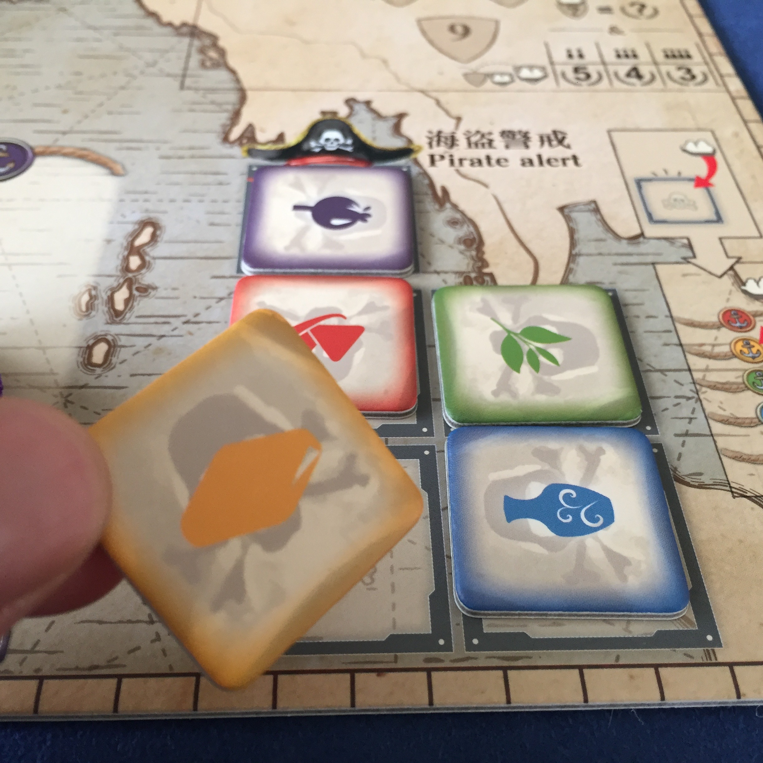 7A. Pass. Spend one action to pass, then take one of these raid markers. At the beginning of the next round, gain a cargo ship from the general supply of the matching good!