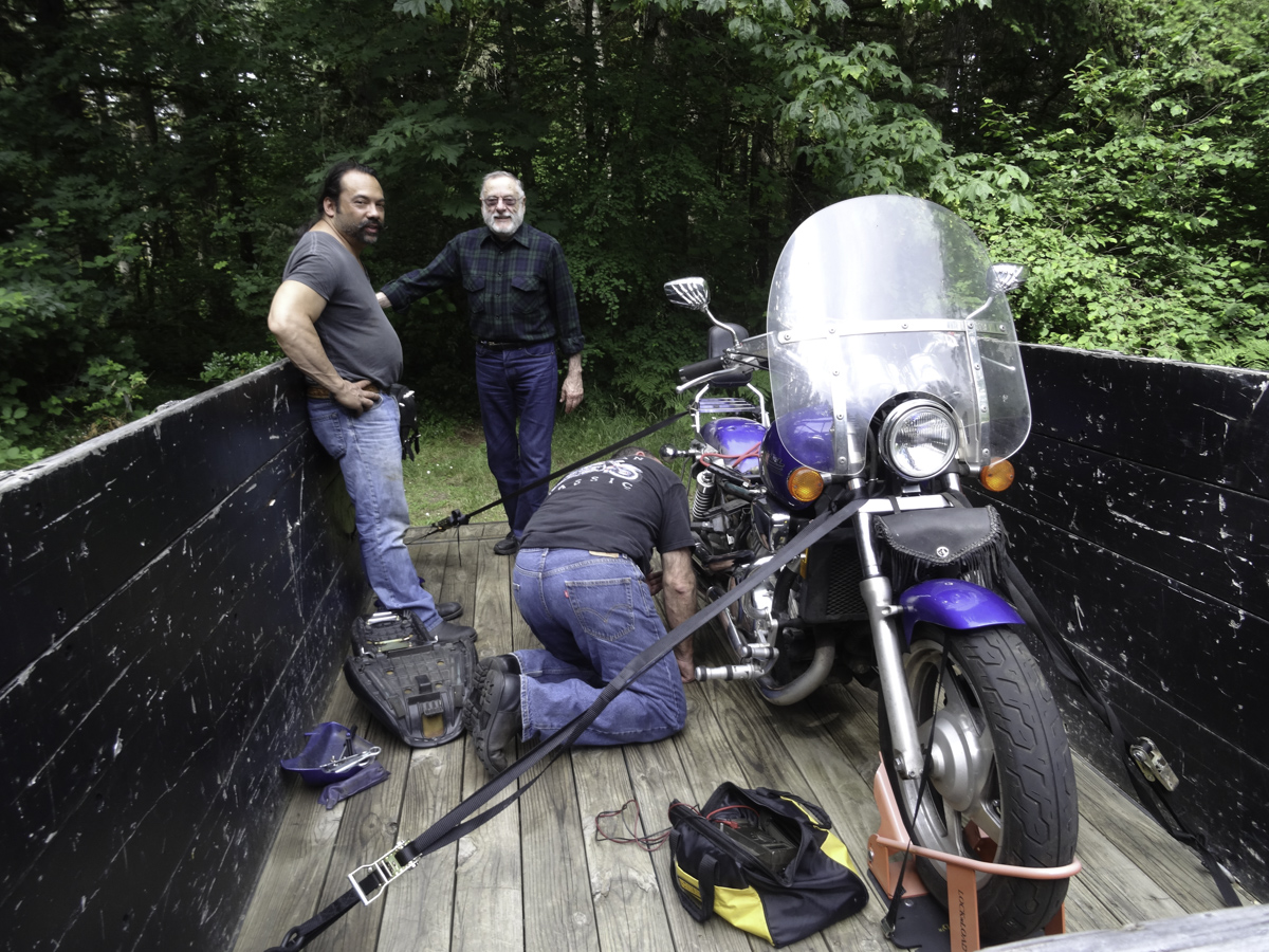Mike's V65 gave up the ghost somewhere along the way. Dennis road all the way back to Washington to get his trailer. Attempts to repair at camp were not successful as an electrical component failed. BRMC guys stick together.