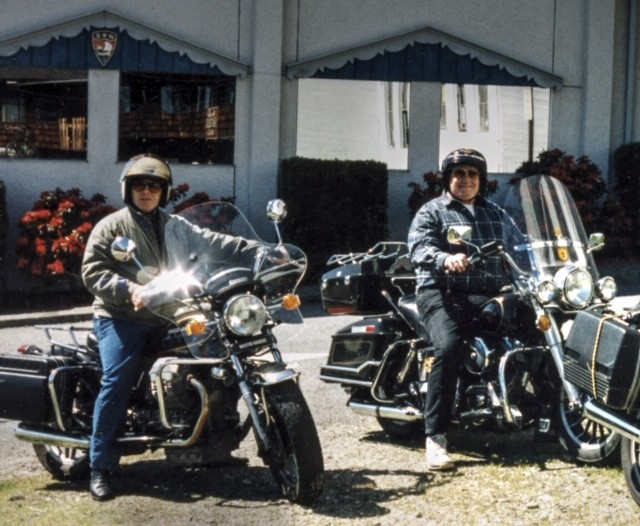 Rex on his Guzzi and John on his Harley in front of Sons of Norway, Poulsbo 1995