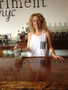 Bridget Firtle with Owney's Rum in the tasting room at Noble Experiment