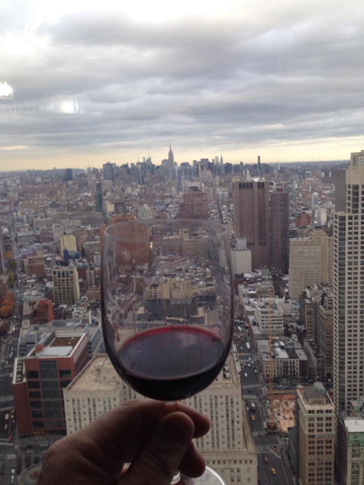 wine glass over city