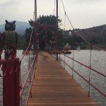 an owl guards the foot bridge