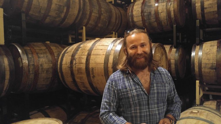 Head Brewer Peter Kiley in its barrel room where beers age in rum, whiskey and wine barrels.