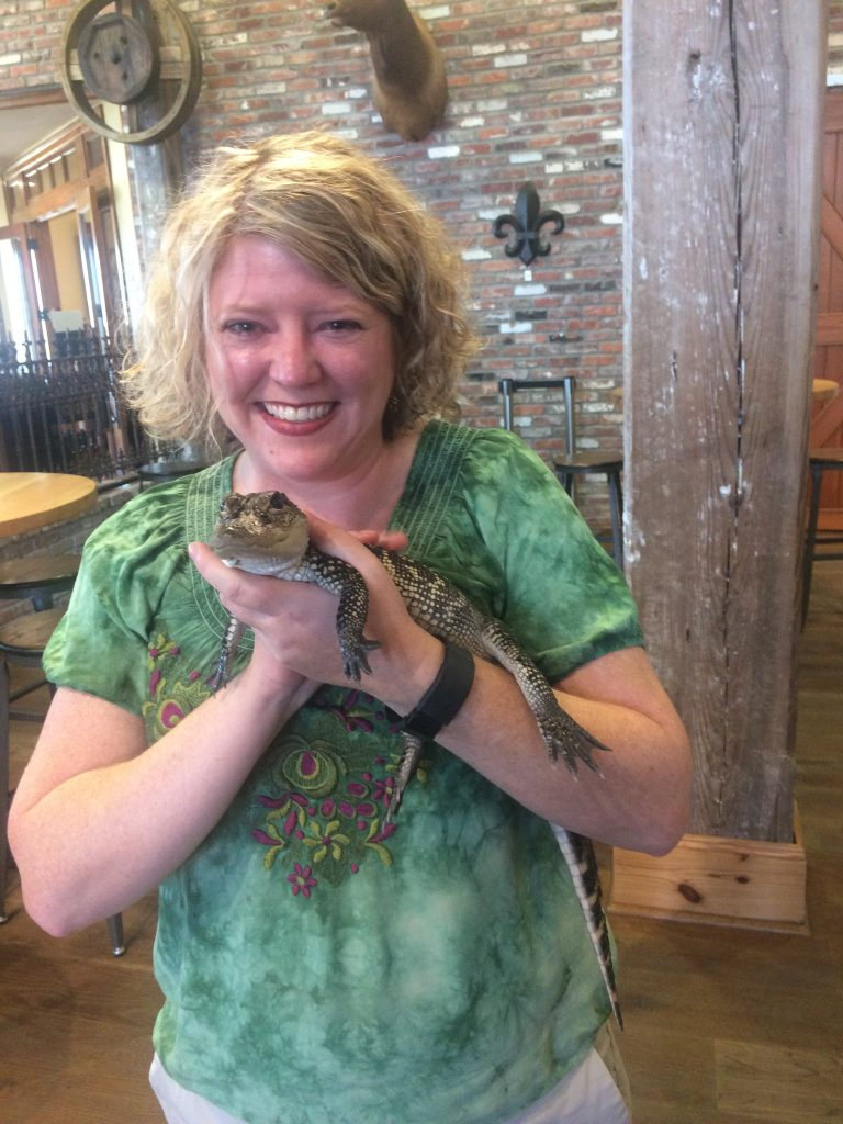 The author and a cuddly baby gator!