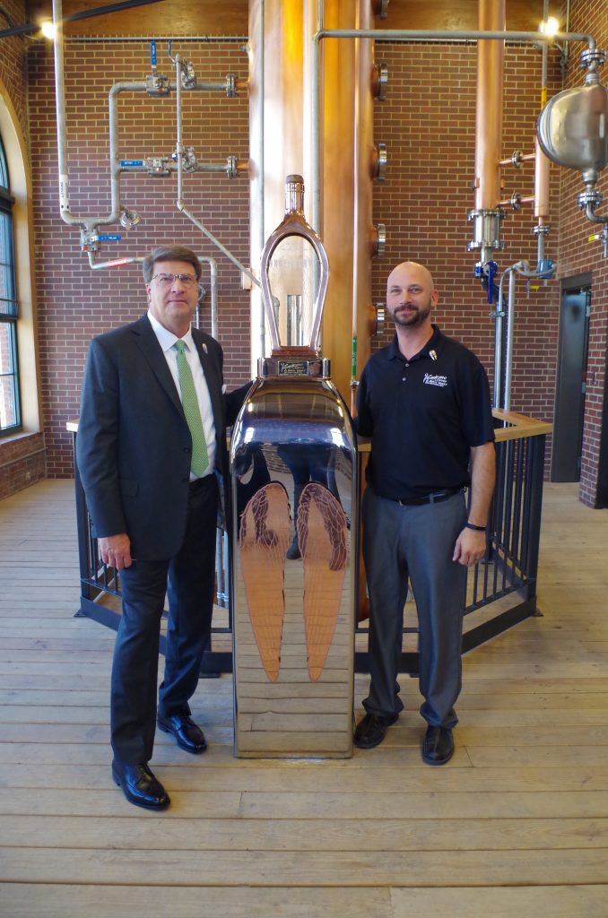 Wes Henderson (L) and Erick Ander Anderson of Vendome Copper Works at the grand opening, photo by Maggie Kimberl