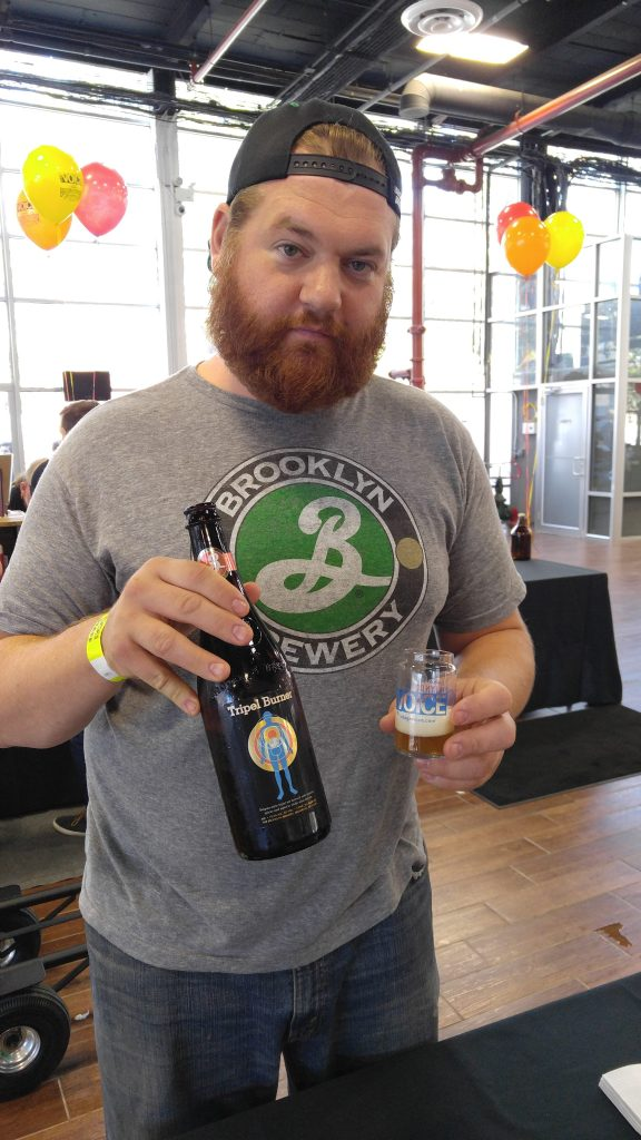 T.J. Smolka of Brooklyn Brewing pours a Triple Burner