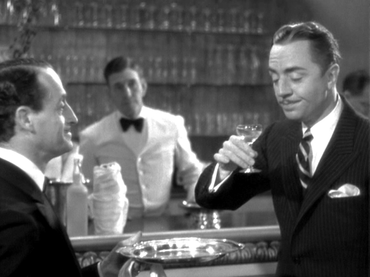 """William Powell (R) as Nick Charles, a.k.a. """"The Thin Man"""", waxing poetic with a shaken Martini"""