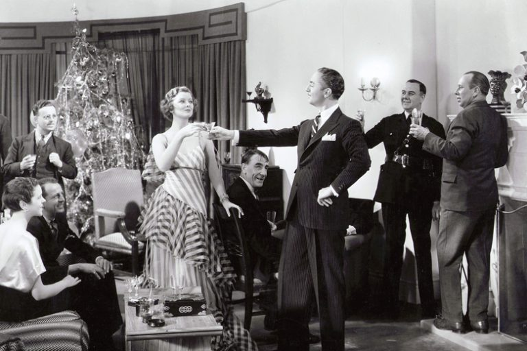 Nick and Nora (William Powell and Myrna Loy) clink mini Martini glasses in The Thin Man