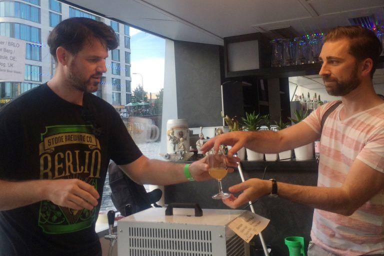 handing over a glass of the Sunburst Sour
