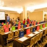 Rainbow of gift bags awaiting seminar attendees at Grape Escape- Peru's Pisco Varietals, photo Peru Trade Commission of Miami