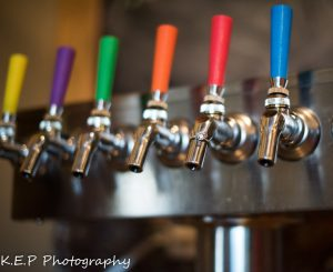 color coded taps facilitate the beer ordering system at Brewability, photo via K.E.P. Photography