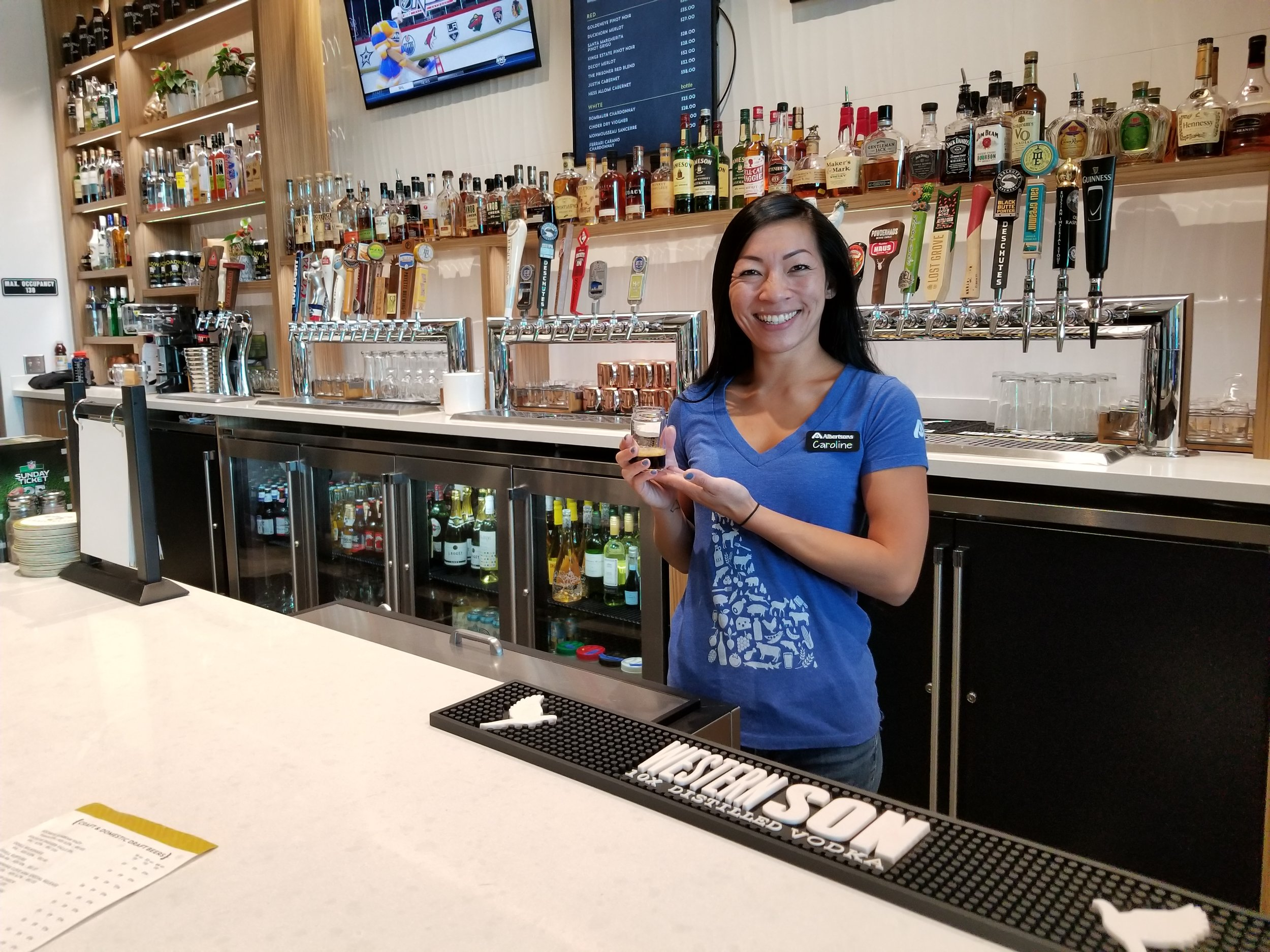 Bartender Carolyn Tang serves a beer sample with a smile at Broadway on the Rocks in Albertson's, Boise.